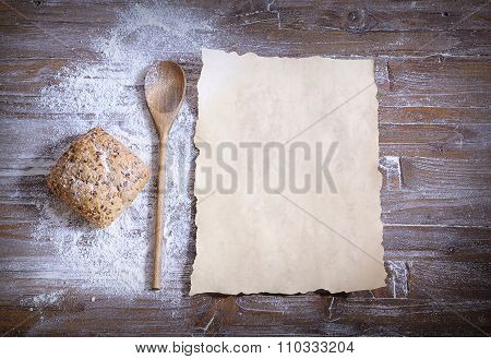 Bun With Sesame, Scattered Flour, Spoon And Baking Paper