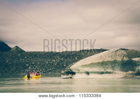 A Yellow Boat Glacier Cruise In Tasman Lake With Vintage Colour Effects