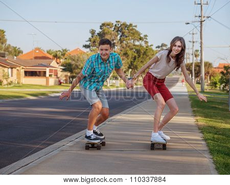 Brother And Sister With  Skateboard