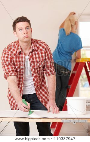 Young Man Fed Up With Decorating Home
