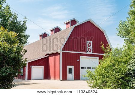 Traditional Red Barn Under Blue Skies