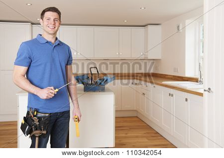 Workman Installing Beautiful Fitted Kitchen