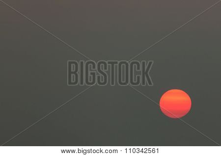 Big sun on the sky at sunset with yellow orange gradient colors.