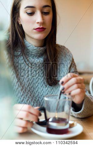Beautiful Young Woman Drinking Tea In A Coffee Shop.