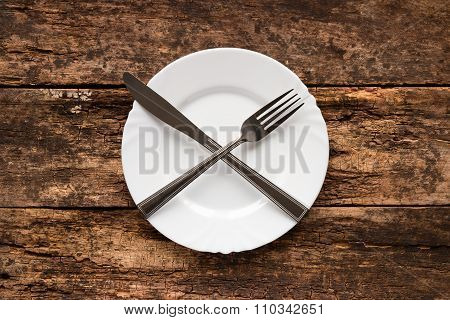 Plate With Lying Crosswise Knife And Fork
