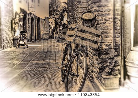 Old Bike With Wooden Case Against A Brick Wall In Sepia Tone