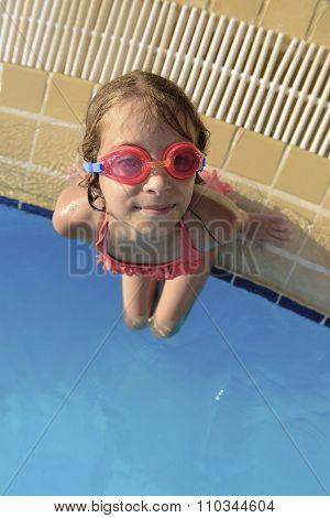 Young Girl At Swimming Pool Looking At Camera