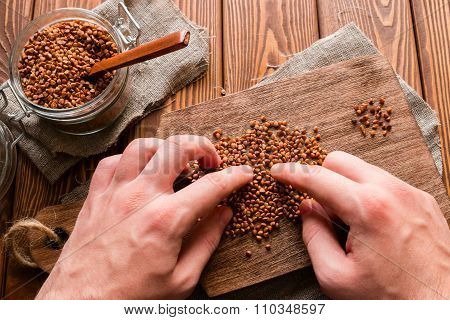 Man Separates Bad Buckwheat Groats