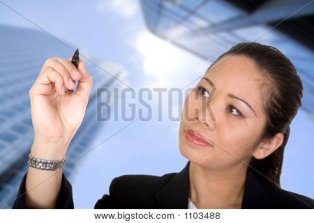 Asian Business Woman Writing On Screen