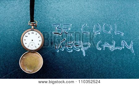 Vintage pocket clock and text on frost car window. Kee p calm concept