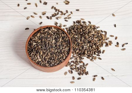 Seeds Of A Milk Thistle (silybum Marianum, Scotch Thistle, Marian Thistle ) On Wooden Table