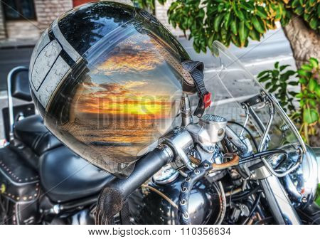 Colorful Sunset Reflected On A Motorcycle Helmet