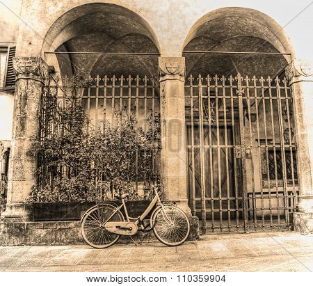 Old Bicycle Parked By A Beautiful Loggia In Sepia Tone