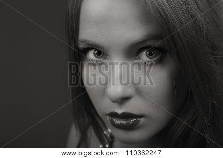Beautiful brunette on a black background.