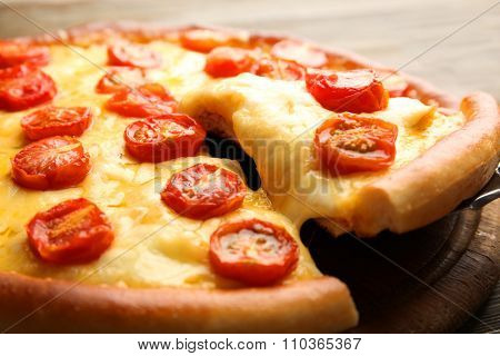 Pizza Margherita and removed slice