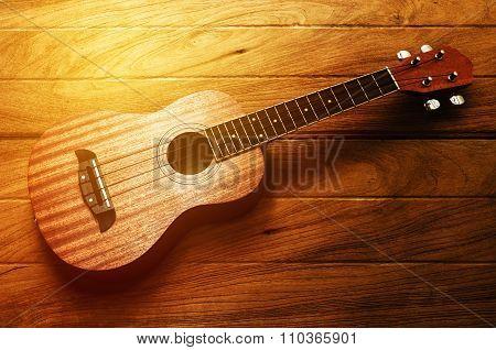 vintage ukulele guitar on wood table background