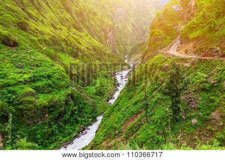 Beautiful mountain river landscape from stone footpath with rocks in Nepal,  Annapurna trekking