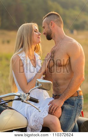 photo biker couple on a motorcycle in the field