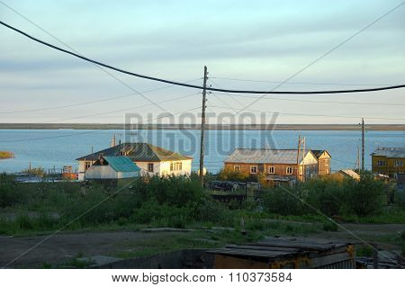 Houses Of Chersky Town At Kolyma River Coast
