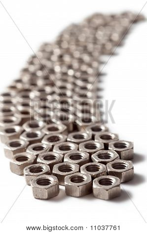 Screw Nuts Lying In A Row