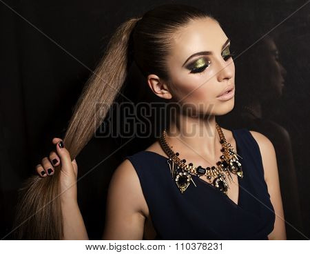 Woman With Dark Hair And Evening Makeup,wears Luxurious necklace