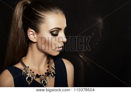 Woman With Long Dark Hair And Evening Makeup,wears Luxurious necklace