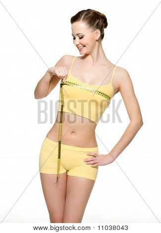 Pretty Smiling Woman Measuring Breast
