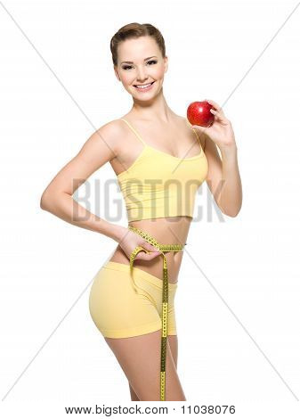 Woman With Beautiful Sporty Body Measuring The Wistline