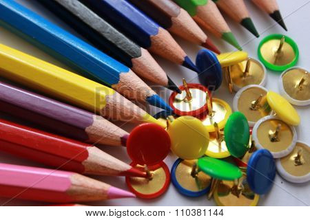 colorful fastener and pencil