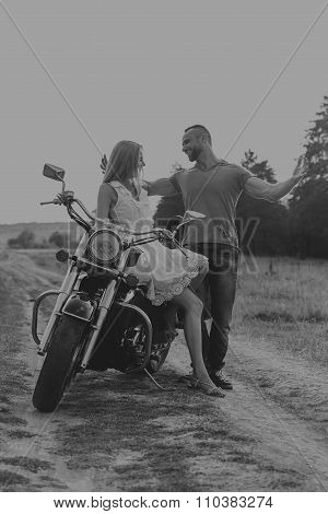 Beautiful couple in love on the chopper