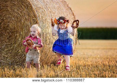 Kids Playing In Wheat Field In Germany