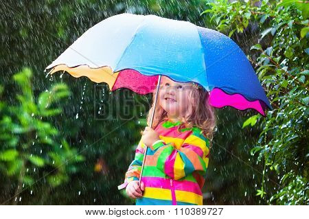 Little Girl Playing In The Rain Under Umbrella