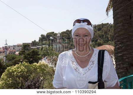 Mature Woman In A White Headscarf Smiling