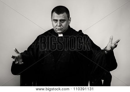 The actor plays the role of a priest