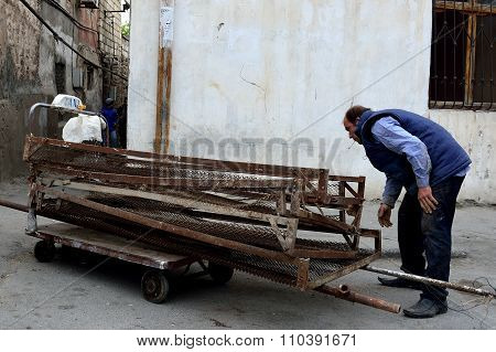 Hand trailer with taxi sign being pulled by a man in Baku, capital of Azerbaijan