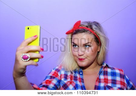 Pretty Blog Girl With Blue Eyes Making Selfie With Her Yellow Smartphone