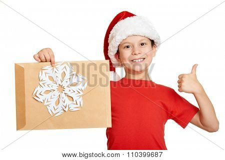 boy in red hat with letter to santa - winter holiday christmas concept