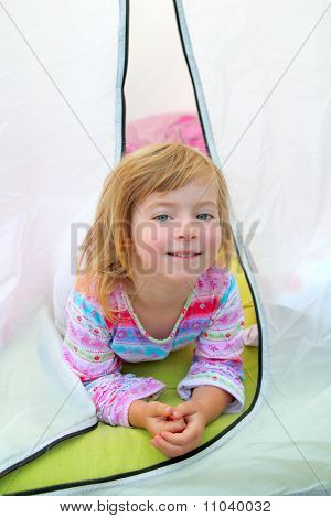 Girl In Camping Tent Lying On Camp Tent