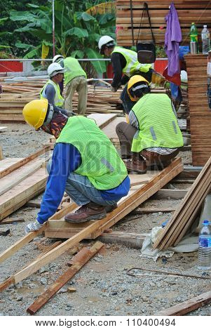 Carpenter fabricating timber form work at the construction site