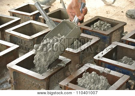 Cube test. Mould of concrete for checking of concrete quality work or compression tests.