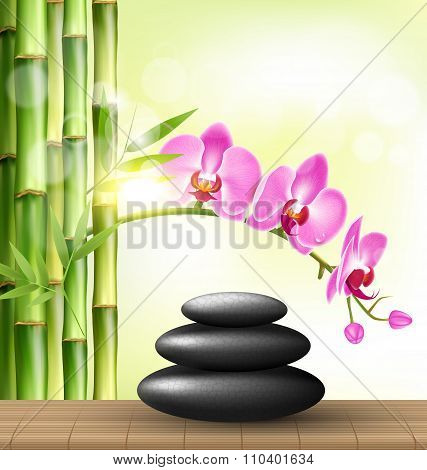 Stack of spa stones with orchid pink flowers and bamboo and sunl