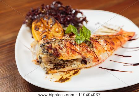 Mouthwatering fried fish cooked with vegetables.