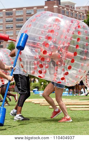 Woman Wearing Plastic Ball Runs Bubble Gauntlet At Atlanta Event