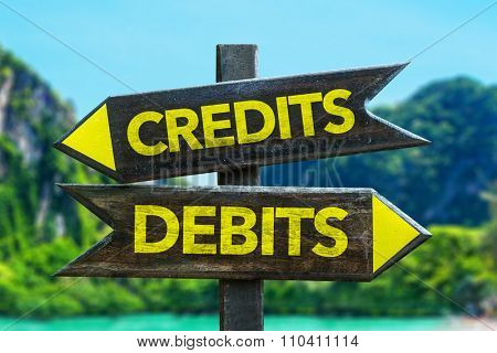 Credits - Debits signpost in a beach background