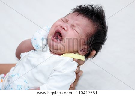 Closeup of Newborn Baby on mother hands 13 days old