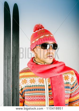 Skier In Knitted Wool Dress With Ornament And Sunglasses