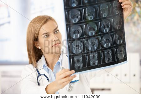 Young Radiologist Looking At X-ray Image