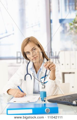 Young Female Doctor Working In Office