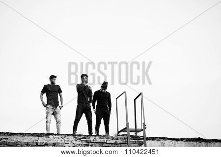 Three Rap Singers Band On The Roof