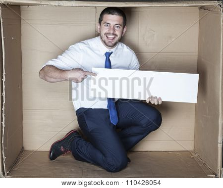 Very Happy Businessman Holding Ad